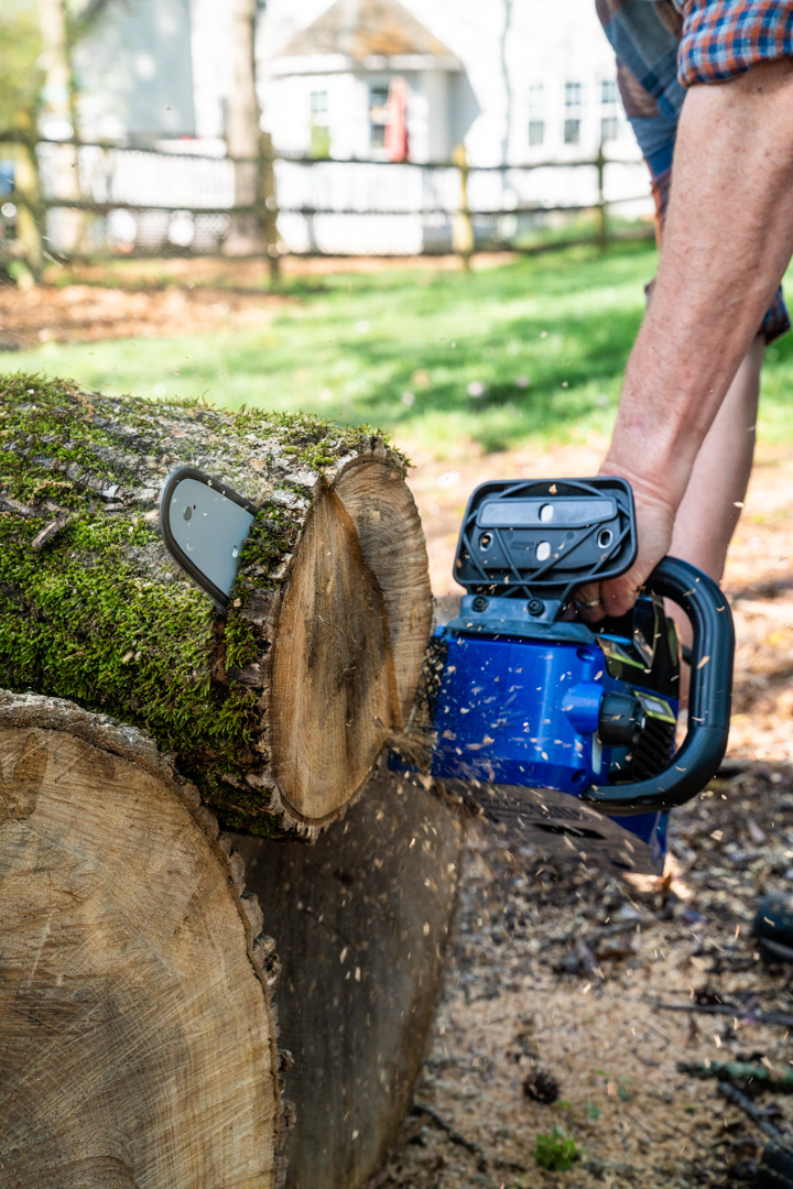 40 Volt Chain Saw from Wild Badger Power cutting logs