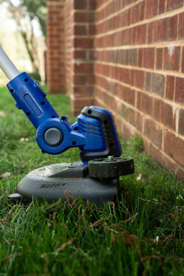 20Volt String Trimmer/Edger from Wild Badger Power against the wall